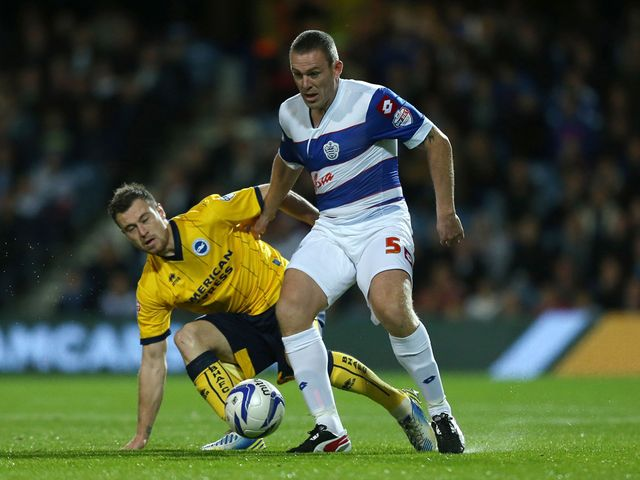Ashley Barnes and Richard Dunne battle for the ball