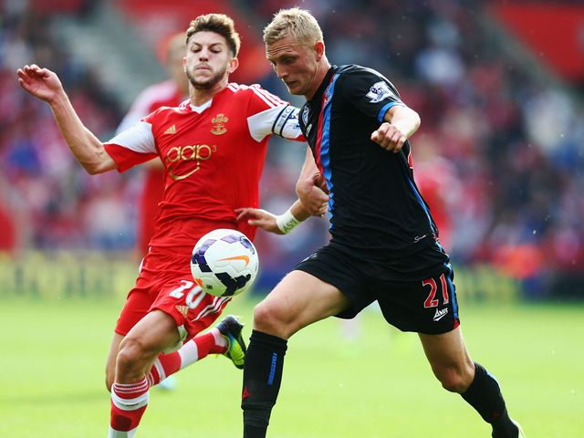 Dean Moxey holds off Adam Lallana