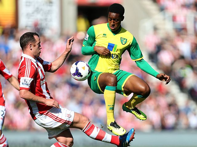 Charlie Adam and Leroy Fer compete for the ball