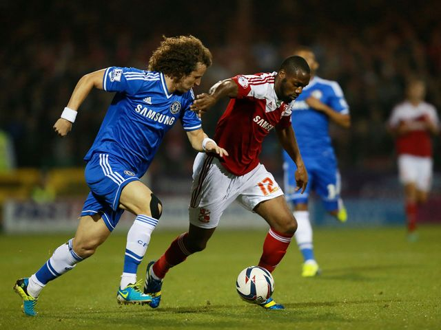 Dany N'Guessan gets away from David Luiz.