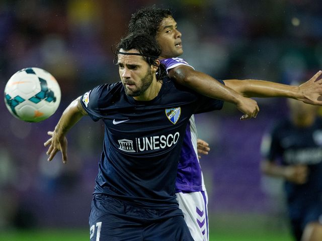 Sergio Sanchez competes for the ball with Humberto Osorio