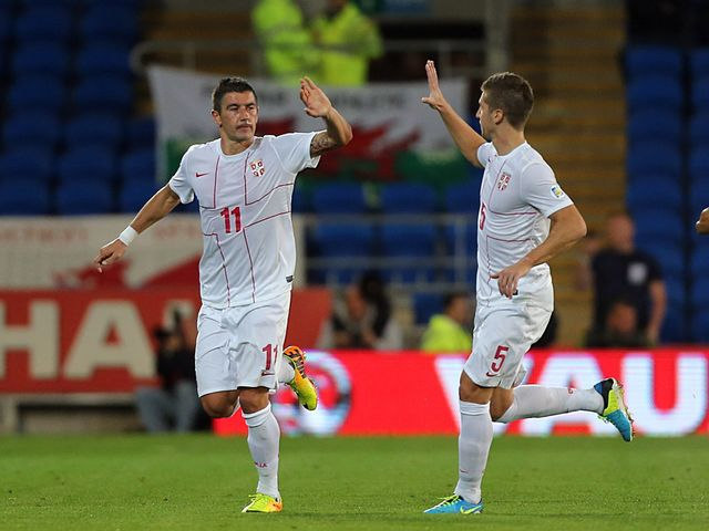 Aleksandar Kolarov celebrates his goal for Serbia