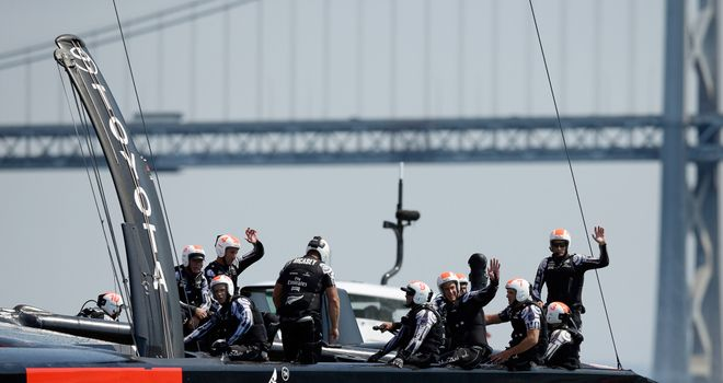Emirates Team New Zealand wave to the crowd after winning race five