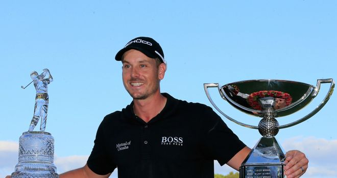 Henrik Stenson with Tour Championship and Fed-Ex trophies