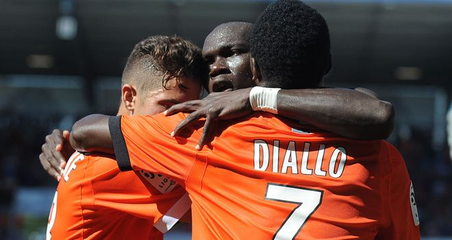 Lorient's Vincent Aboubakar (centre) celebrates