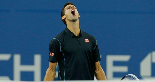 Novak Djokovic celebrates beating Mikhail Youzhny