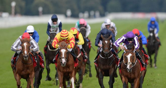 Leading Light (right) holds off Talent (red cap) to take the St Leger