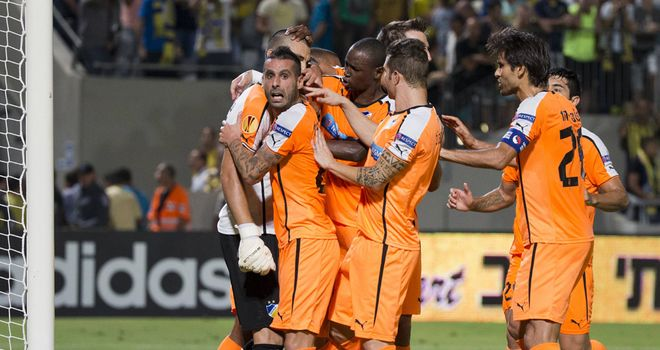 APOEL Nicosia celebrate Urko's penalty save