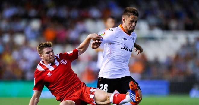 Alberto Moreno and Fede Cartabia battled for the ball