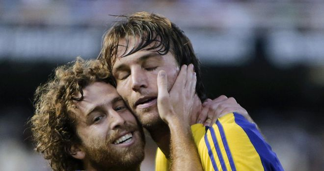 Michu: Celebrates his superb goal against Valencia