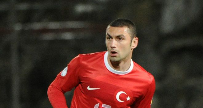 Burak Yilmaz scored the opening goal as Turkey kept their World Cup hopes alive in Romania