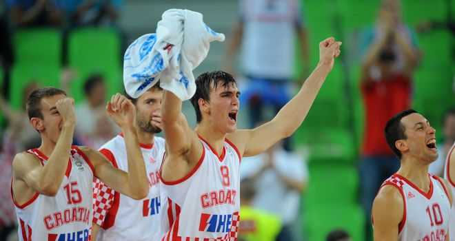 Dario Saric (C) and his Croatia team-mates celebrate victory over Ukraine