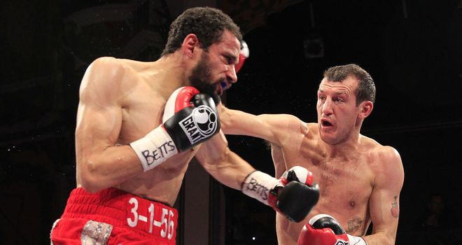 Derry Mathews lands the right hand that ends the contest (Lawrence Lustig)