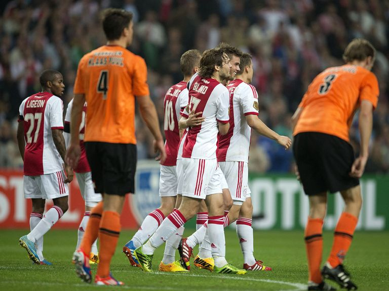 Ajax celebrate as they reach the next round.