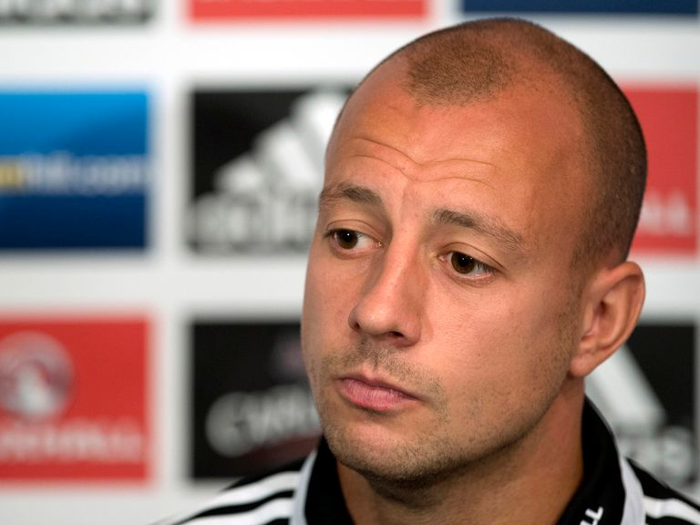 Alan Hutton faces the press.