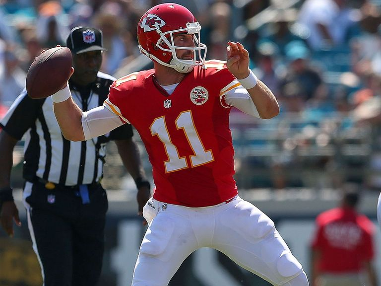 Alex Smith prepares to gun a pass downfield
