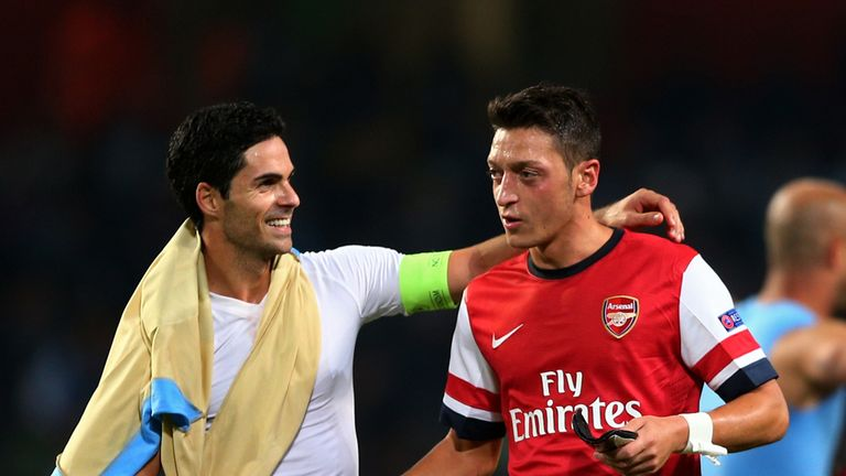 Arsenal skipper Mikel Arteta offers words of encouragement to Mesut Ozil