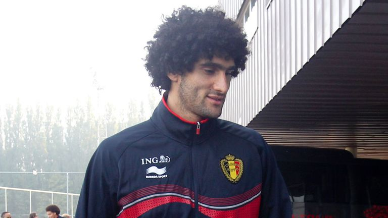 Marouane Fellaini arrives for a Belgium training session on Tuesday