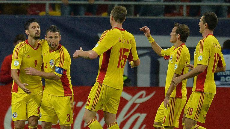 Romania celebrate Ciprian Marica's opening goal