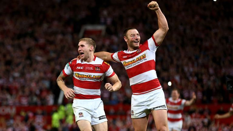 Sam Tomkins (left) and Blake Green celebrate Wigan's victory