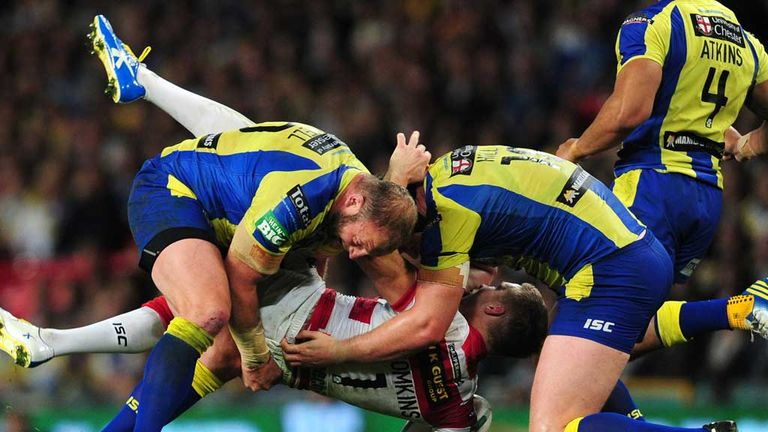 Gareth Carvell (left) tackles Wigan's Sam Tomkins during the Grand Final
