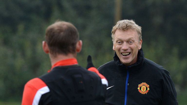 Wayne Rooney shares a joke with David Moyes at Manchester United's training complex