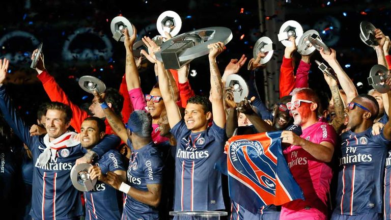 PSG players celebrate winning the Ligue 1 title in May