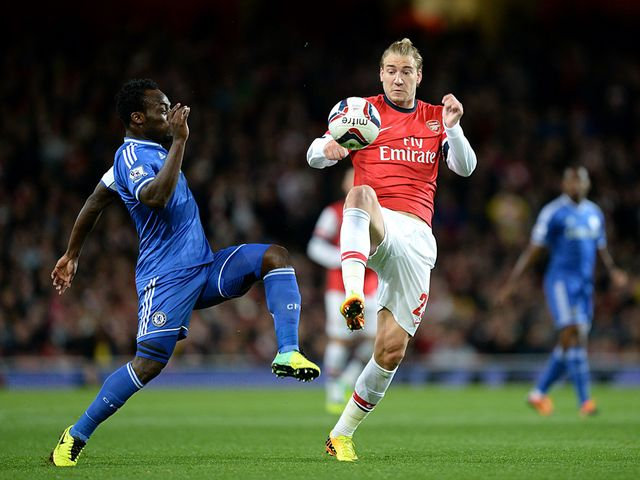 Essien and Bendtner battle for the ball