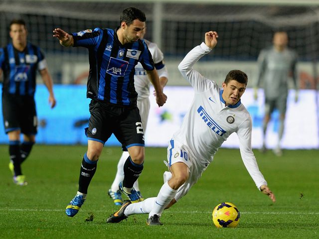 Mateo Kovacic falls to the ground