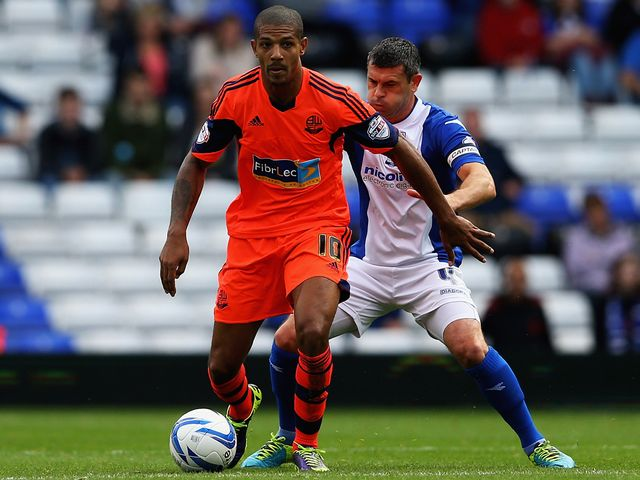 Jermaine Beckford holds off Paul Robinson