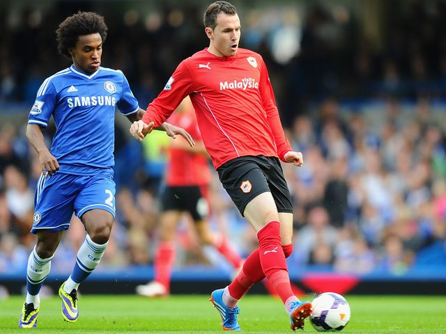 Jordan Mutch gets a pass away as Willian looks on
