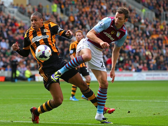 Curtis Davies and Libor Kozak compete for the ball