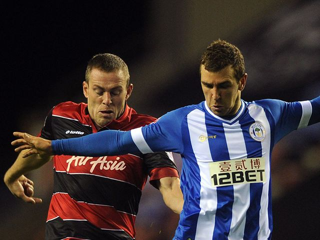 Richard Dunne and James McArthur battle for the ball