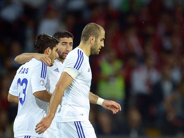 Armenia celebrate their surprise opening goal