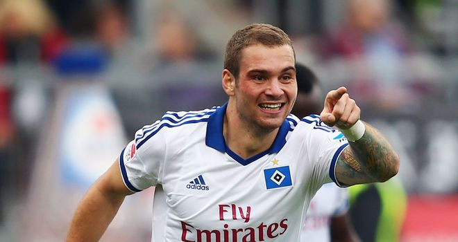 Pierre-Michel Lasogga celebrates scoring for Hamburg