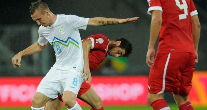 Jasmin Kurtic and Blerim Dzemaili tussle for the ball