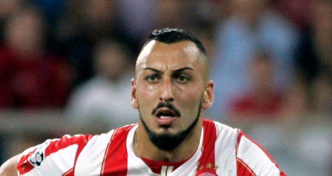 Kostas Mitroglou: Bagged a hat-trick in Olympiakos win