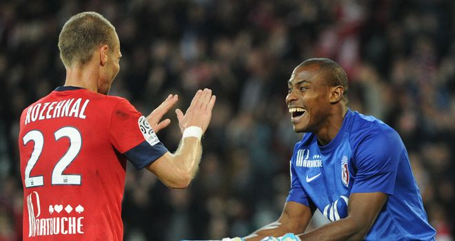 David Rozehnal and Vincent Enyeama celebrate for Lille