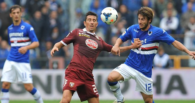 Giuseppe Vives and Gianluca Sansone battle for the ball