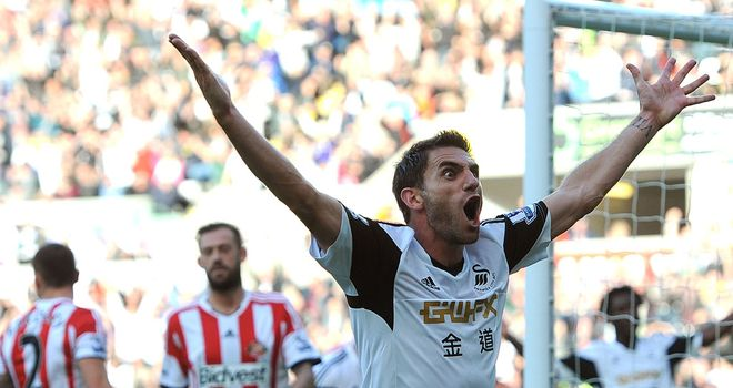Angel Rangel: The Swansea full-back celebrates after his side's opening goal during the 4-0 win over Sunderland