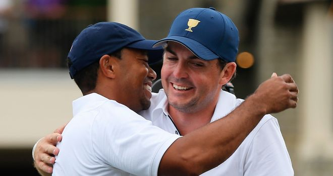 Tiger Woods is hugged by Keegan Bradley after claiming the winning point