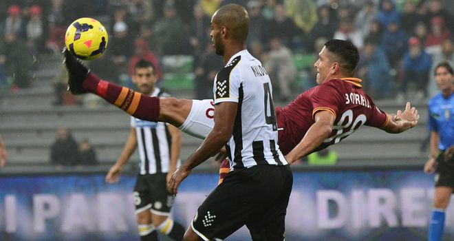Marco Borriello fights for the ball.