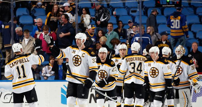 The Boston Bruins celebrate their 5-2 victory over the Buffalo Sabres