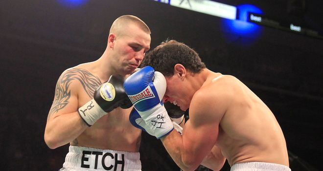 Adam Etches lands a punch during his victory over Alexandre Mendes of Brazil at the Motorpoint Arena in Sheffield (photo courtesy of Lawrence Lustig)