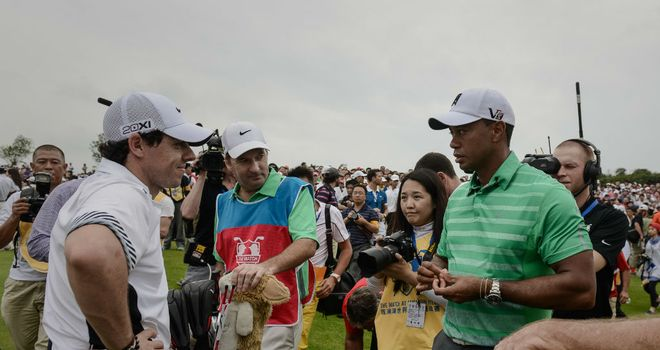 Rory McIlroy and Tiger Woods chat in China