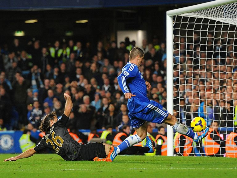 Fernando Torres scores Chelsea's winner against Manchester City.