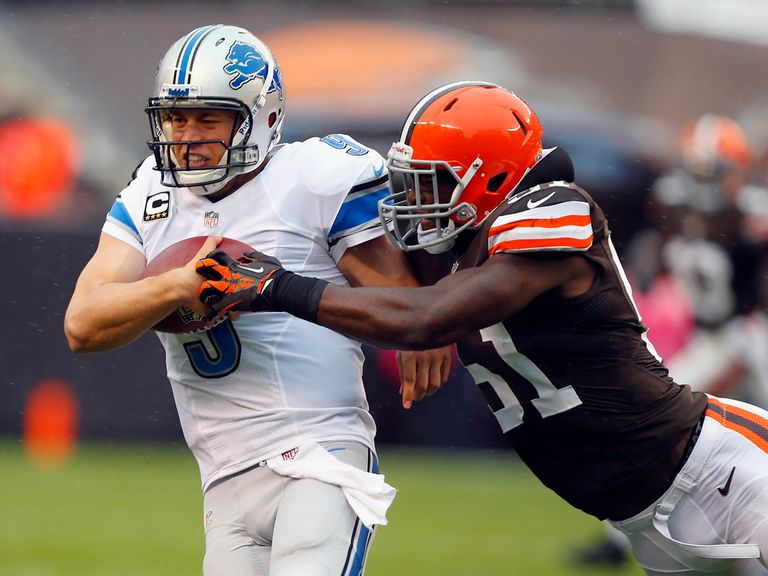 Matthew Stafford is halted by Barkevious Mingo.