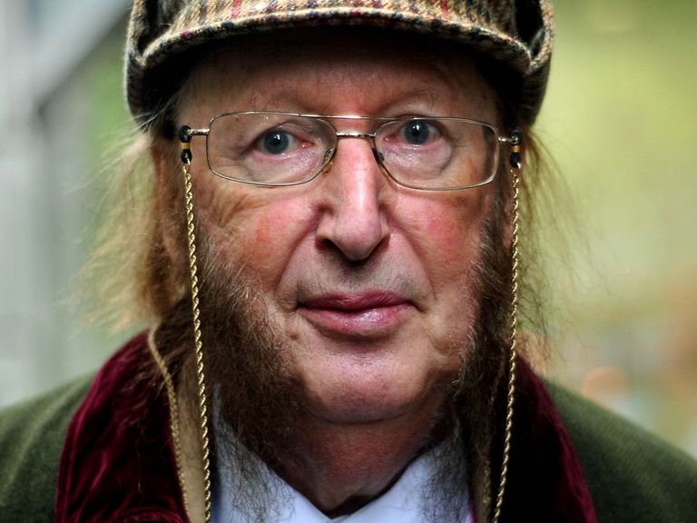 John McCririck arriving at court on Friday