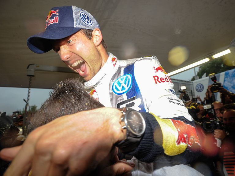 Sebastien Ogier celebrates his seventh victory of the season
