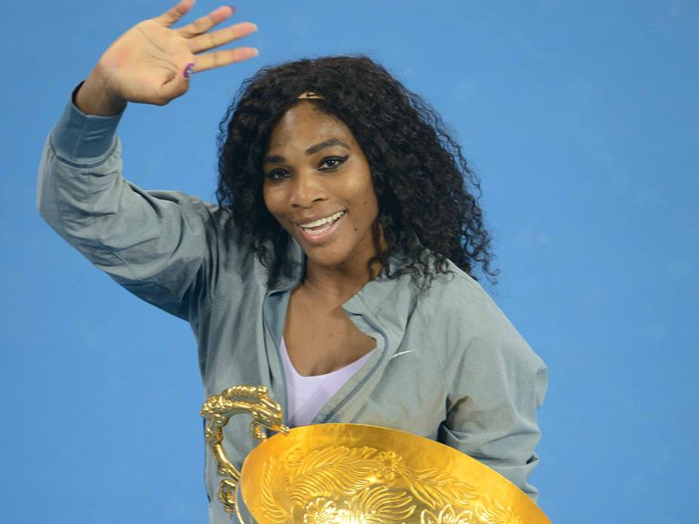Serena Williams celebrates her China Open win, her 10th WTA title of the season